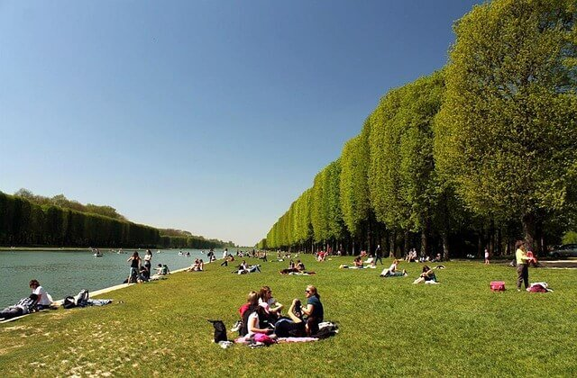Picnicking beside the Grand Canal - Chateau de Versailles