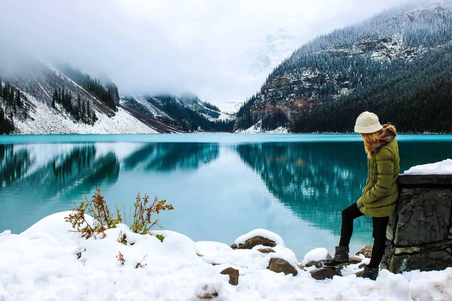 Woman traveling near lake