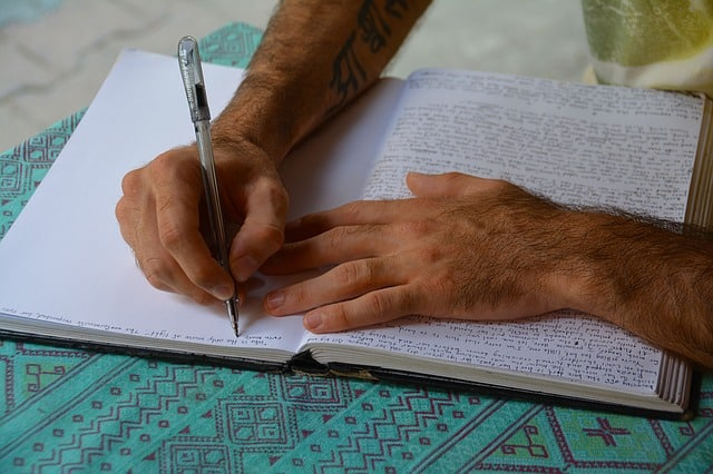 person-writing-journal