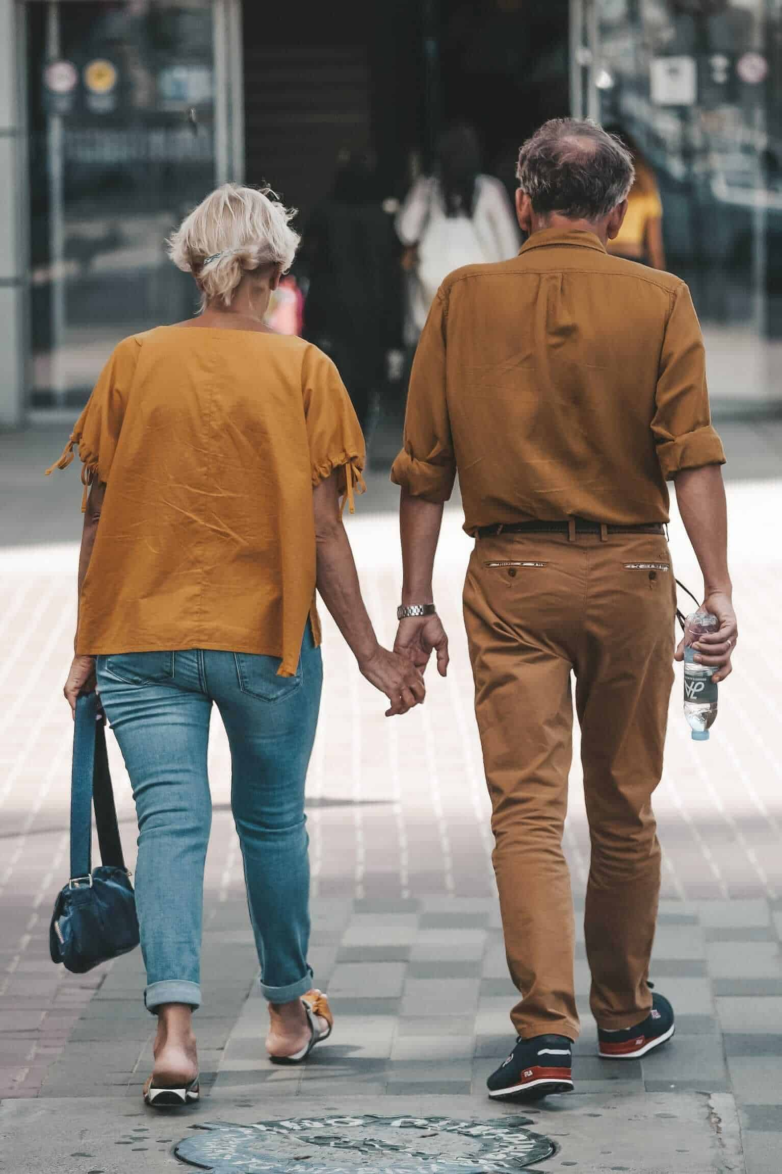 senior people traveling with clasped hands